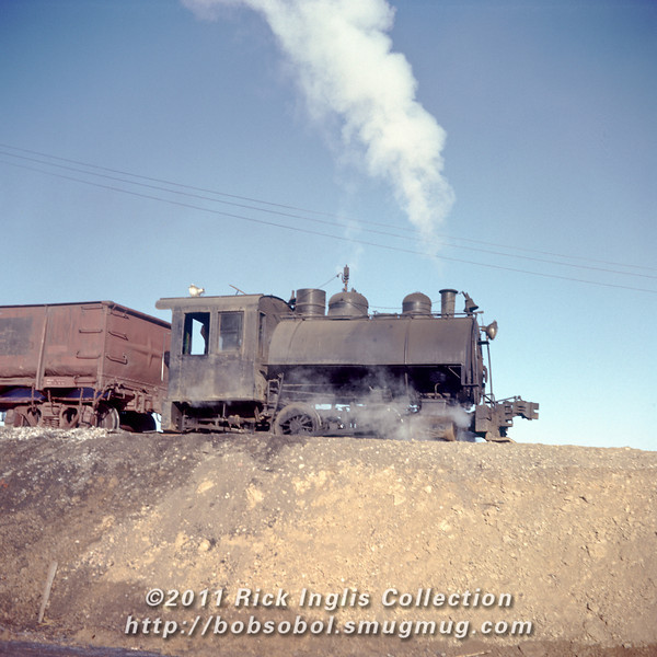 Slide No. 133. Great Western Sugar's 0-4-0 unloading sugar beets at Loveland, 1956.
