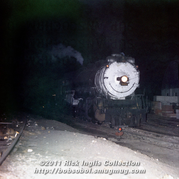 Slide No. 772. C&S 909 soutbound leaving Fort Collins, Feb 1958. Super Anscochrome, light struck in center through film identification band.