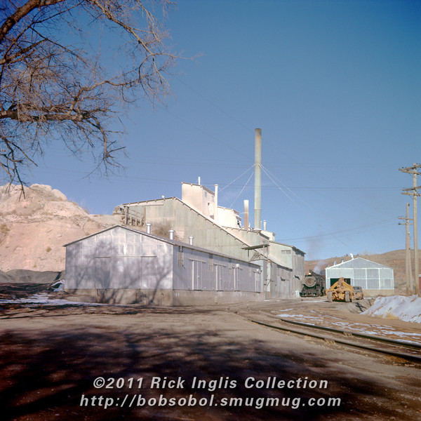 Slide No. 163. Gypsum plant and quarry by Devil's Backbone west of Loveland. Two steam locomotives are visible—both standard gage C&S and peeking around the left side of the upper plant, a steam dinkey.