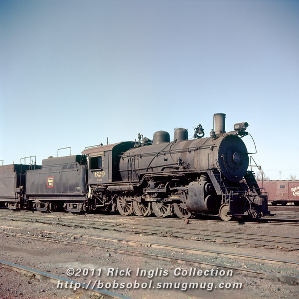 Slide No 215. C&S 625 in the dead line at Denver. Part of the valve gear has been removed.