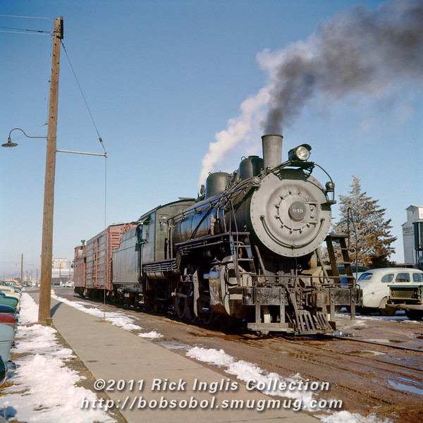 Slide No 139. C&S 2-8-0 #648 in Greeley, CO, running on the track west of the UP passenger depot, currently out-of-service on the Great Western.