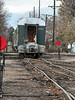 """The last run for GW's passenger cars, switching in the west end of Loveland yard, November 14, 2002. For some reason the switching involved a lot of movements of two scale test cars and an aborted attempt to couple this passenger car to a tank car with shelf couplers (which would be a really """"bad thing."""")"""