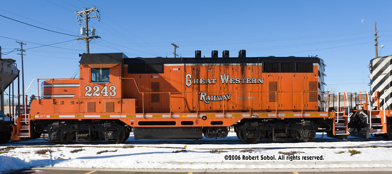 "Great Western's ex-Santa Fe rebuild GP7. The ""liberated"" 4-stack exhaust also seems to be liberating crankcase oil. The engineer went for beans at Carl's Jr., across the street and behind the locomotive. 12-09-2006, outside the Greeley Freight Station Museum at 10th Street."