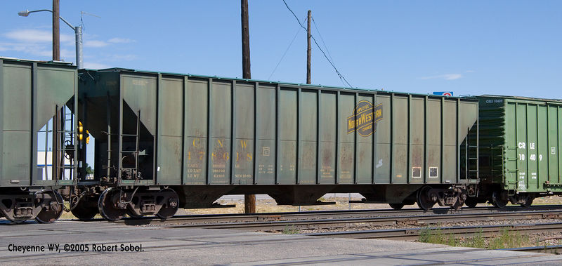 C&NW grain hopper withmild rust and good grime. Cheyenne, WY Sept 2005.