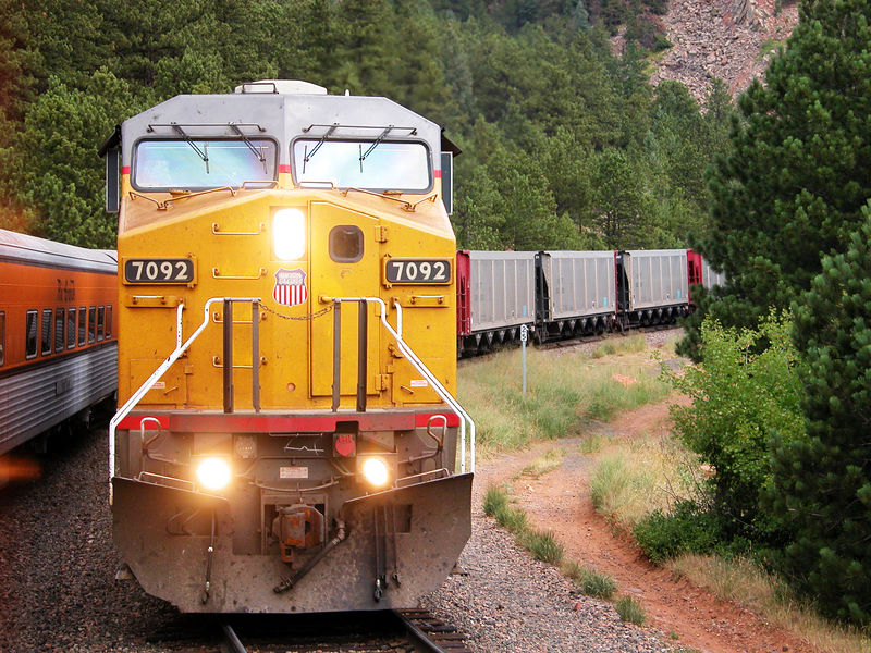 I can think of many worse ways to spend a morning than waiting in the hole on the Ski Train at MP 25 (Plain) of the Moffat district for an eastbound coal drag. August 3, 2002.