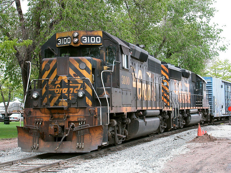 GP40-2 3100 and 3129 idle behind Jefferson St. station in Fort Collins while the crew goes for beans, May 24, 2002.