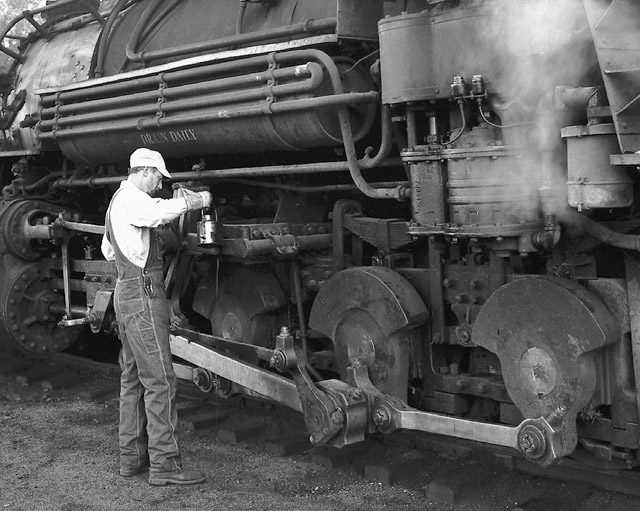Fireman oiling a K36 after the day's run.