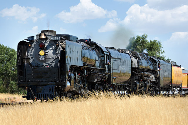 On amber waves of grain, Union Pacific 844 and 3985 drift downgrade through Carr, CO, July 21, 2005.<br /> <br /> Given the current sad state of affairs at the UP steam shop it is not clear if either of these will ever run again.