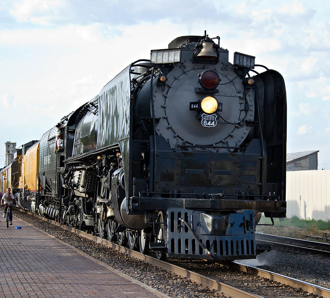 844 accelerates from a stop at the Greeley depot.