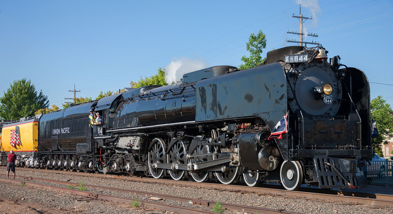 844 stops for a scheduled lube job in Greeley. She and Centennial 6936 are pulling the 2013 Cheyenne Frontier Days train. Note that the red Mars light has been removed.
