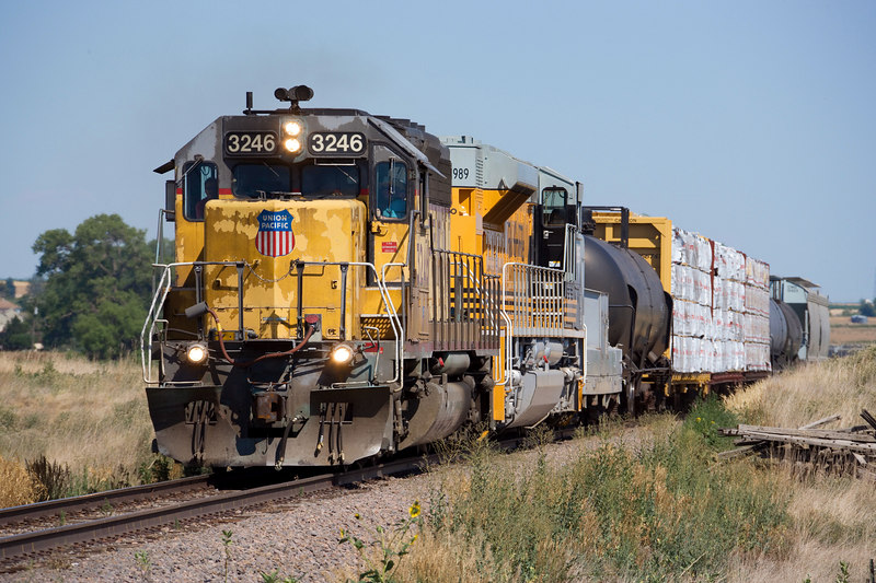 On July 15 2006 the Fort Collins local's power through Officer Junction (Kelim) was a beat-up SD40-2 and the new Rio Grande Heritage unit. All the cars for interchange with the GW would not fit at Officer, so the UP had to run the extras, including an MP scale test car, to a siding closer to Fort Collins before returning to Milliken for public display.