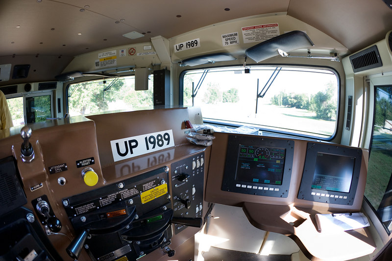 UP 1989 cab. The white box hanging down in the left window is a video camera.
