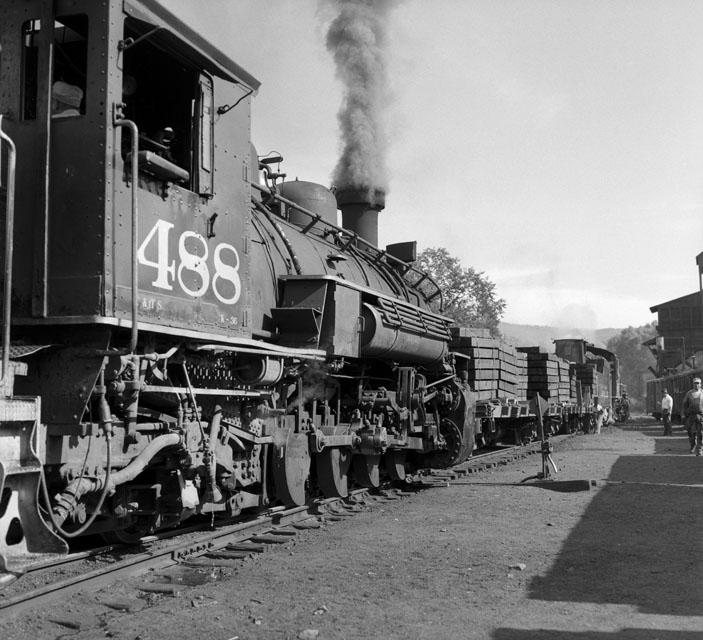 K36s #488 and #489 prepare to leave Chama NM for Cumbres Pass, where #489 will uncouple along with flat cars loaded with track supplies. Later that day, 489 will narrowly miss being hit by a gasoline tanker on US 17 as she turns on the wye to back down to Osier to rescue the southbound. 484  developed a hot box on right #2 driver.