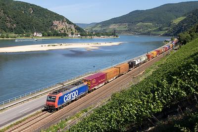 SBB Cargo's 482 010 heads a southbound Intermodal service past Assmannhausen. Wednesday 5th July 2017.