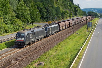 MRCE 182 514 has 189 803 DIT on a lengthy train of northbound coal hoppers passing Dattenberg. Tuesday 4th July 2017.