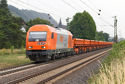 Just before the thunderstorm and cloudburst, 2016 906 of RTS, heads a northbound ballast train past Leutesdorf, north of Koblenz. Thursday 6th July 2016.