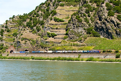 A Class 482 emerges from Roßstein Tunnel on the east bank with a southbound Intermodal service. Photographed from the west bank at Oberwessel. Wednesday 5th July 2017.