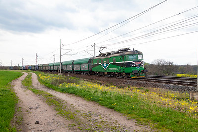 SD Kolejová Doprav's 130 053 passes Zaluzi level crossing with southbound loaded coal hoppers. Tuesday 19th April 2016.