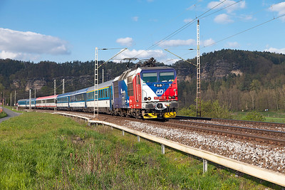 "Czech flag liveried 371 201 (Ex DB 180 001) heads the EC177 Hamburg to Praha ""Johannes Brahms"" south past Strand near Rathen. Wednesday 20th April 2016."