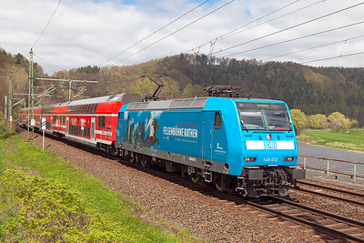 146 013 heads an S Bahn service to Schöna approaching Königstein. It carries a livery advertising the open air theatre at Rathen. Wednesday 20th April 2016.
