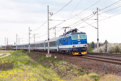 371 003 'Jana' heads the EC173 Hamburg to Budapest consisting of MAV stock past the level crossing at Zaluzi. Tuesday 19th April 2016.