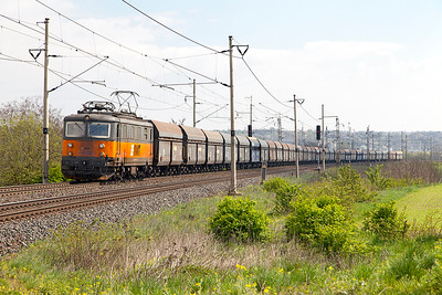 AWT's 121 038 passes the level crossing at Zaluzi northbound with empty hoppers. Tuesday 19th April 2016.