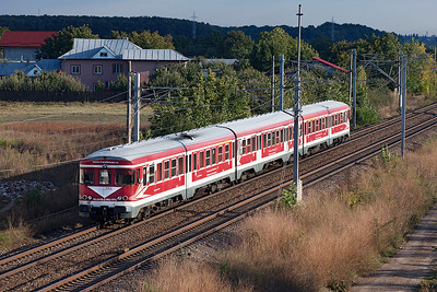 In the last of the evening light Transferoviar Calatori's Ex DB Class VT-624 DMU 76-2418 is south of Buftea forming 15053 17.27 Buchuresti Nord to Buzau via Ploiesti. Tuesday 24th September 2013.