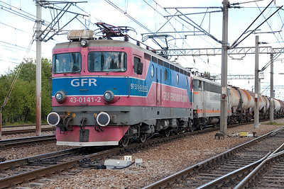 With a freindly wave from the crew GFR 43-0141 has Ex SNCF 425-215 dead in train as it departs Chitila Yard with northbound tanks. Tuesday 24th September 2013.