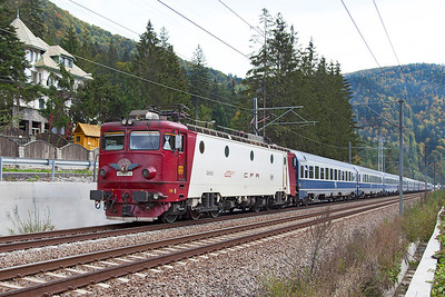 41-0747 with a Cluj-Napoca depot badge heads the IC346 13.10 Buchuresti Nord to Vienna overnight sleeper is north of Sinaia. Thursday 26th September 2013.