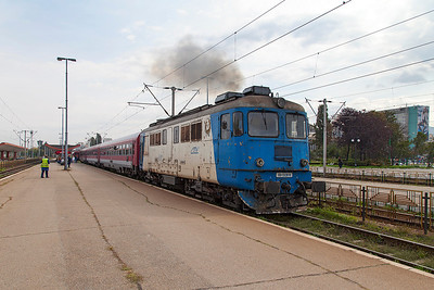 Having arrived behind electric traction 477-821 the IR1621 10.00 Buchuresti Nord to Timisoara departs Brasov behind a tatty 60-1328 now running as a 3 coach consist. Thursday 26th September 2013.