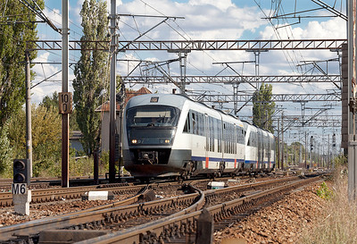 A pair of Class 96 2 car Siemens Desiro units depart from Chitila forming R9109 15.10 Bucuresti Nord to Titu. Tuesday 24th September 2013.