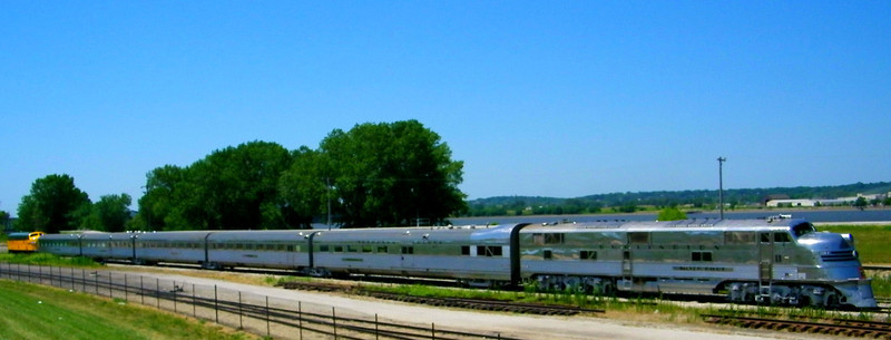 Illinois Railway Museum's Nebraska Zephyr articulated trainset, with a Chicago & North Western locomotive on the tail.  The consist is parked beside the Mississippi River, downstream of Train Festival grounds which are off camera to right.