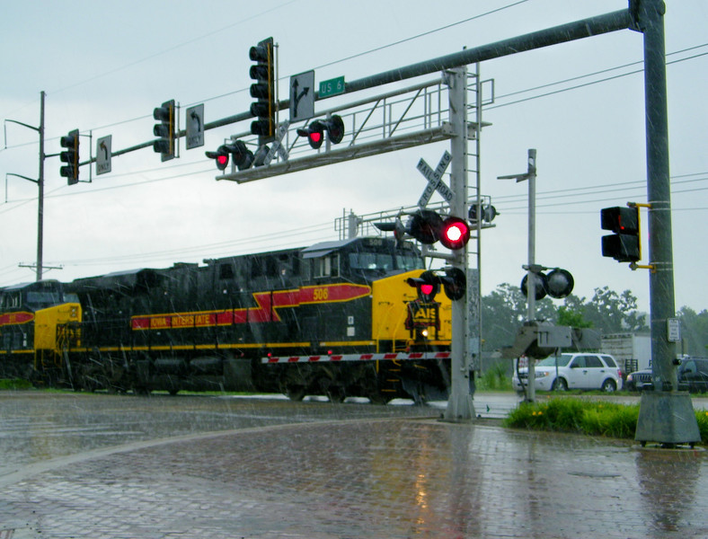 Iowa Interstate manifest freight in the rain at U.S. 6 junction just east of Iowa City.