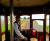 The motormen take turns at the controls.  This gentleman is narrating the eastbound run before running the car westbound as the current motorman assumes the talking duties.