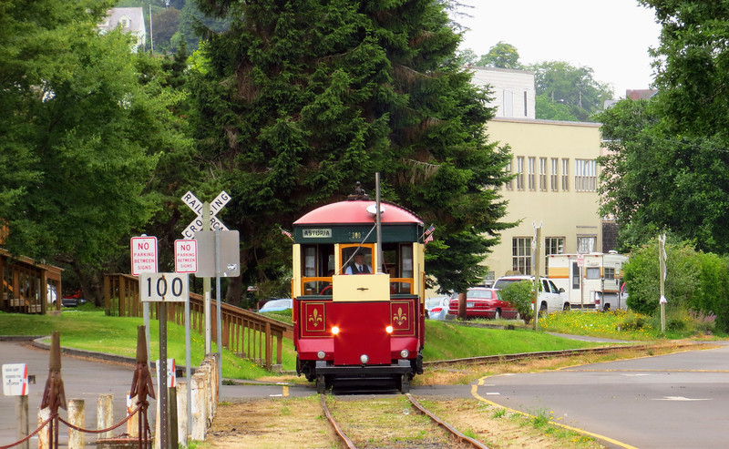 The streetcar approaches, running eastbound (upstream) along the riverfront near the maritime museum.  Note generator cart being pushed ahead of car.