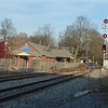 Brunswick, Maine - Two new signals installed because Brunswick now has passenger service for the first time in over 50 years.  We are at the east end of the passenger platform on 11/12/2012 - My digital camera does an excellent job of capturing color except for railroad signals. There is nothing wrong with the signals they were displaying a standard solid red color.