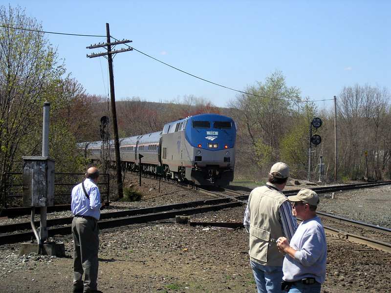 Palmer, Mass. - Railfans gather near the diamond crossing to watch Amtrak's Vermonter. The Vermonter is on CSX's former Boston and Albany line. The other line is New England Central (former Central Vermont).