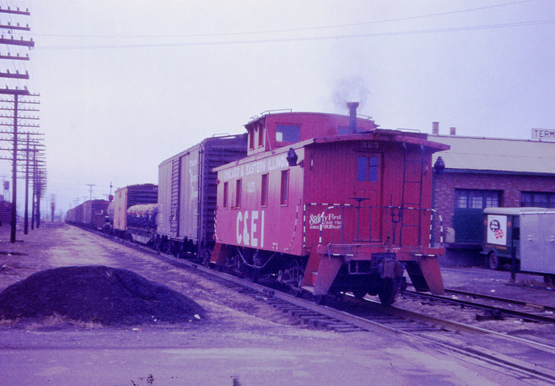 MSCL 80 - Dec 8 1957 - C&EI caboose 325 southbound at Granite City ILL