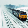 50024 Vanguard raises a plume of snow as it races through Potbridge with an Up Exeter service