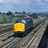 37235 hauls a rake of UCV China Clay hoods past Aller Junction