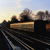 Low winter sunshine imparts a golden glint to this 4VEP as it approaches West Byfleet with a stopping service to Waterloo.
