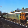 DEMU 205029 in BR green livery stands at Reigate while working a Tonbridge service
