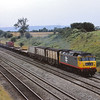 An interestingSpeedlink working heads past Standish Junction headed for Gloucester. <br /> Given the look of the assorted vans, it was possibly heading for Ashchurch MOD depot