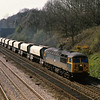 56070 with a rake of loaded stone hoppers powers through Sonning bound for Acton Yard.