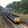 50034 Furious in NSE livery climbs out of Sonning Cutting on its way into the capital<br /> <br /> Scrapped 1991
