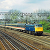 Another class in decline when photographed and soon to vanish.<br /> 85013 passes Kenton heading for Euston