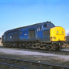 37073  formerly D6773 stands in the sunshine at Millerhill Yard