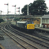 45113 passes Falsgrave box and gantry on the approach to Scarborough<br /> <br /> Circa 1983