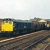 25042 hauls a short rake of tanks through Workington<br /> <br /> Circa 1983