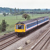 Class 117 DMU L407 at Lower Basildon with a Paddington - Didcot service.<br /> Vegetation growth in the area means this view down to the River Thames is no longer possible.